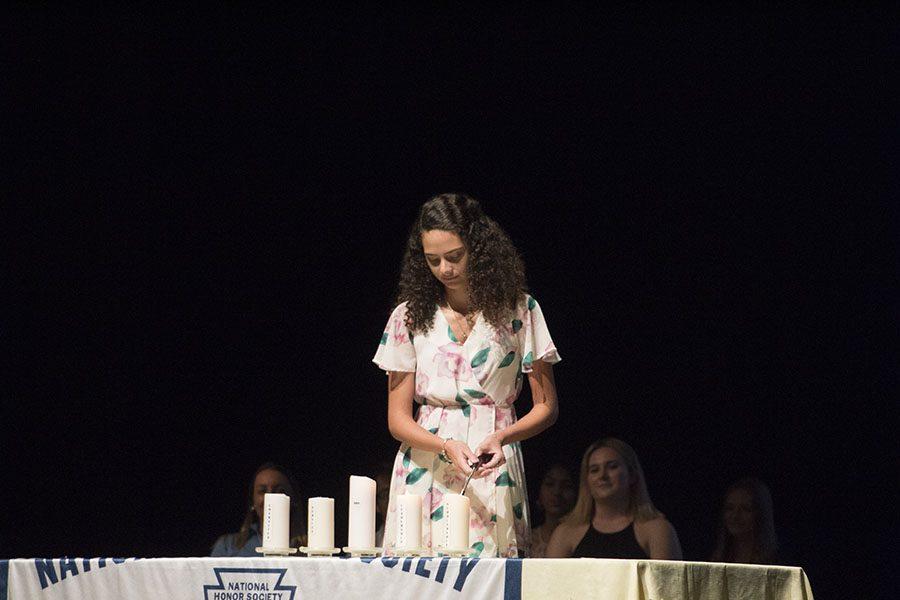 Secretary Lauren Klemowich lighting the scholarship candle.