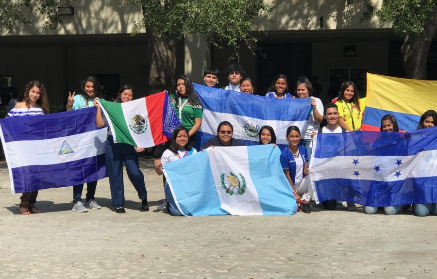 Students show off their country's flags in a show of pride.