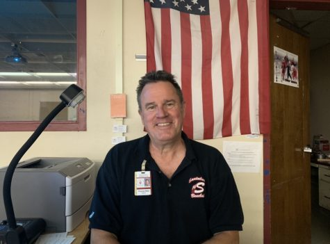 Mr.Wake smiles in his classroom for a picture.
