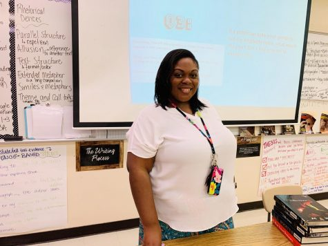 Ms. Marshall enjoys introducing her ninth grade students to the world of reading and writing.