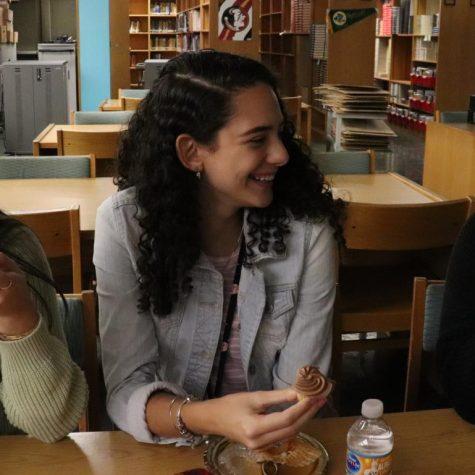 Students, Alayna Reddick, Lauren Klemowich and Sabrina Luu, chatting and eating their treats.