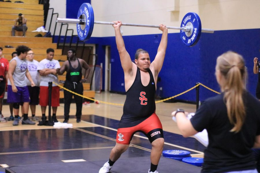 Cordell+is+jerking+135lb+for+his+first+attempt.