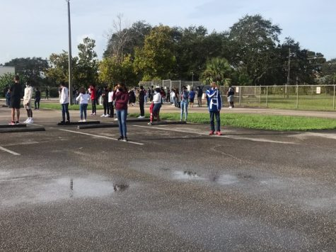 Students stood in the empty teacher parking lot during the first fire drill of the year.