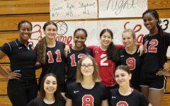 Laura Garcia (in red) alongside her Varsity Volleyball teammates