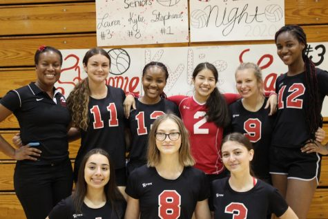 Laura Garcia (in red) alongside her Varsity Volleyball teammates