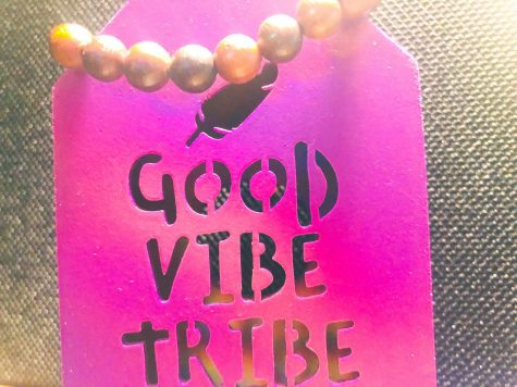 "The ""Good Vibe Tribe"" desk decor alongside my prayer bead bracelet."