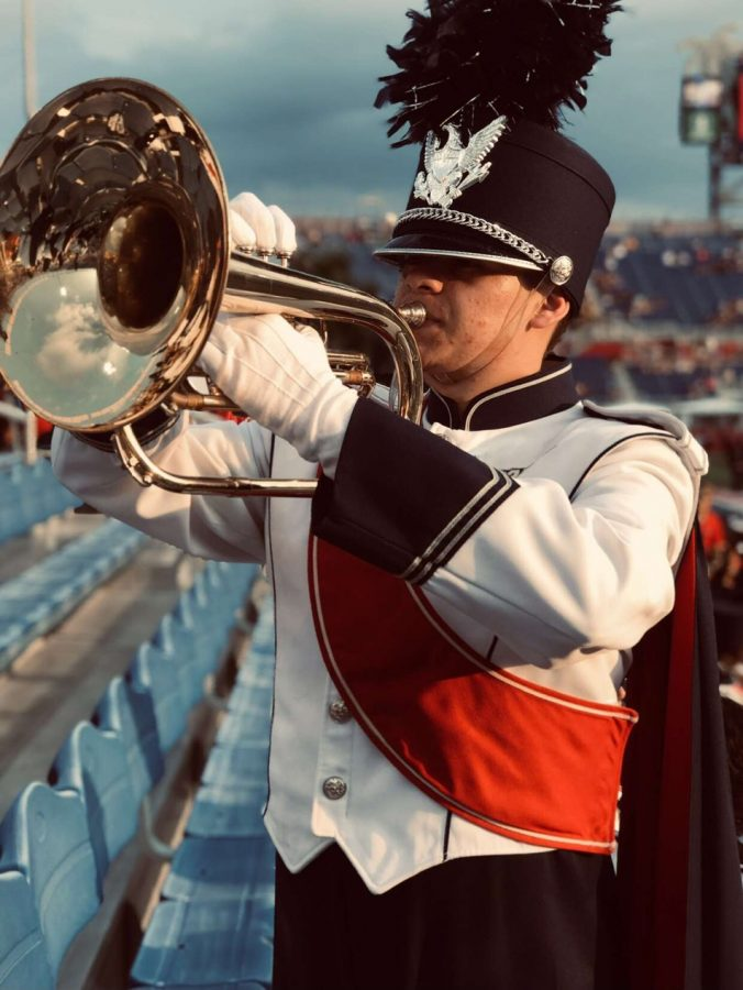 Giancarlo+plays+both+Mellophone+%28Marching+Band%29++and+French+Horn+%28Wind+Ensemble%29+