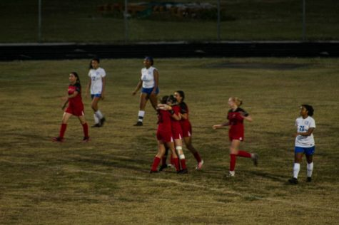The Girls Soccer Team celebrating during a game.