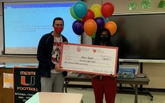 Principal Robinson and Dr. Snyder holding the $5,000 check.
