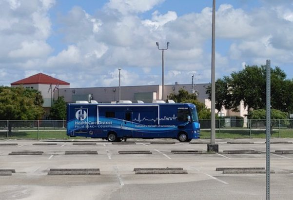 A vaccination bus arrives on campus.