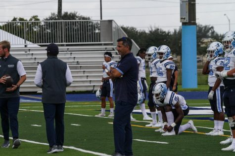 Keiser University Head Football Coach Doug Socha looks on during a practice.