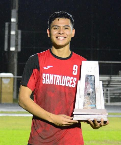 David Perez in his junior year holding the trophy for the District Championship